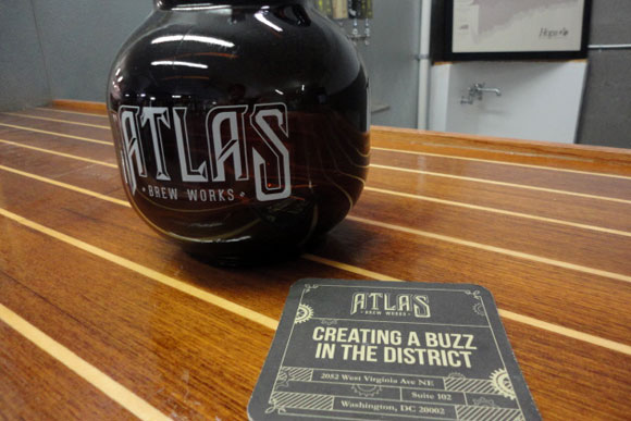 A Pella growler (2 liters) and a coaster