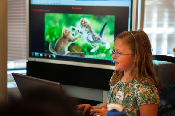Two new organizations in D.C. are bridging the gender divide in tech. Here, Zoey, a Girls Rock On The Web (GROW) participant, shows off the website she built dedicated to her favorite books