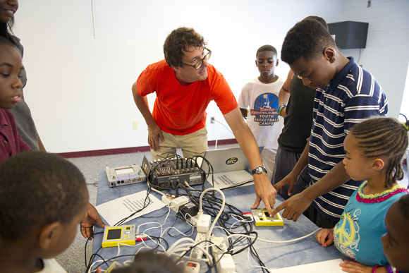 Jones shows kids how to use the touch-screen synthesizers