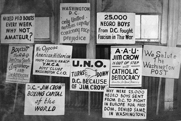 1948: Picket signs protesting the segregation at Uline