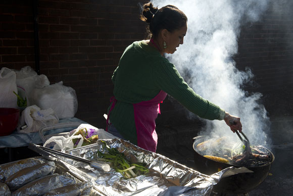 Nancia Sical cooks carne asada and more at the Crossroads Farmer's Market. She is one of a number of women who are hoping to build their small food businesses when Crossroads' new commercial kitchen opens