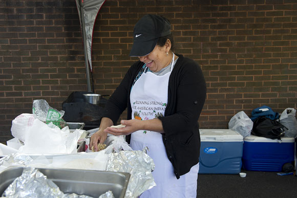 Candy Del Sid makes pupusas at the Crossroads Community Market