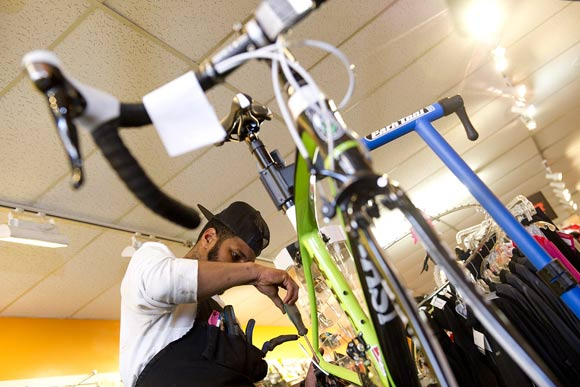 Brandon Lyles, a tech at Capitol Hill Bikes in Southeast, fixes a bike. He'll be volunteering his time to make sure residents East of the River can keep their bikes in working order