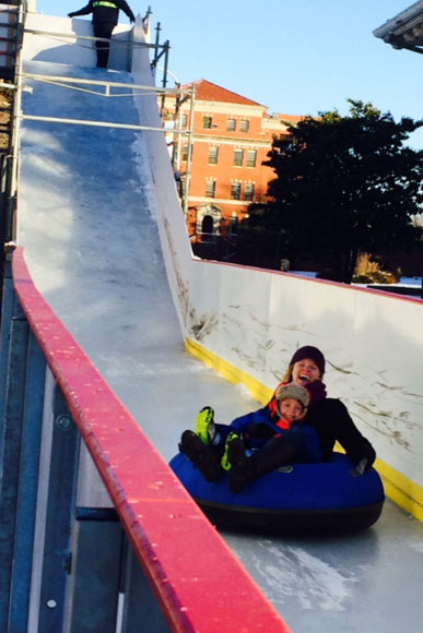 Cherry Tolliver, of Alexandria, and her four-year-old son, ride the slide