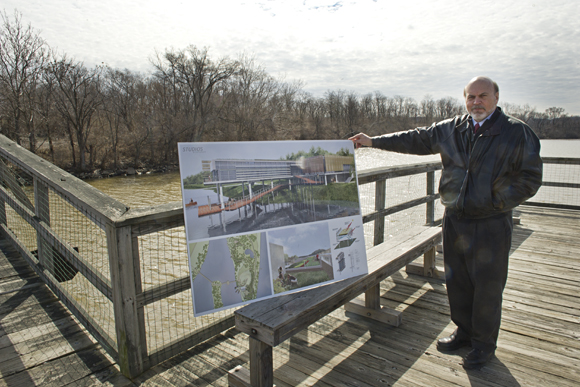 Steven Mutschler, managing director for Living Classrooms of the National Capital Region, with renderings for a proposed nature center on Kingman Island on the Anacostia River