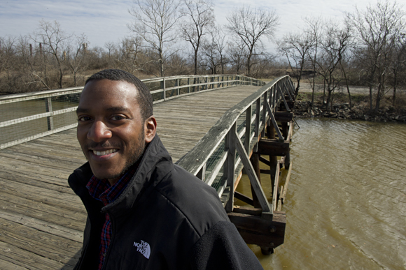 Bryant Curry, program coordinator for Kingman Island, at the bridge leading to the manmade island