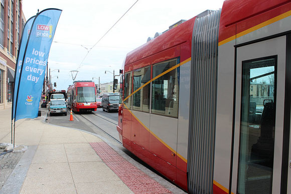 A streetcar passing the Giant grocery store on H Street