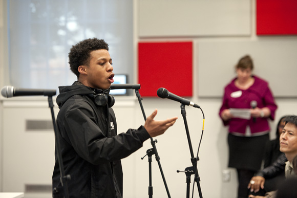 Taijai Williams, a member of the DC Youth Slam Team, performs a poem at #accessartDC