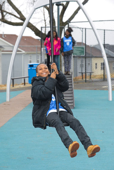 A child rides a zip line at a renovated D.C. playground